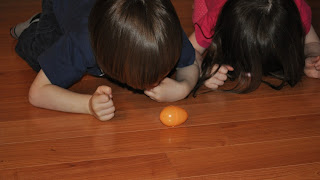 Build gross motor skills by having egg races with plastic eggs