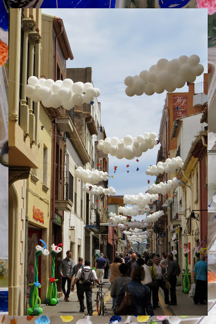 Balloon Clouds over the streets of Palafrugell in Costa Brava, Spain