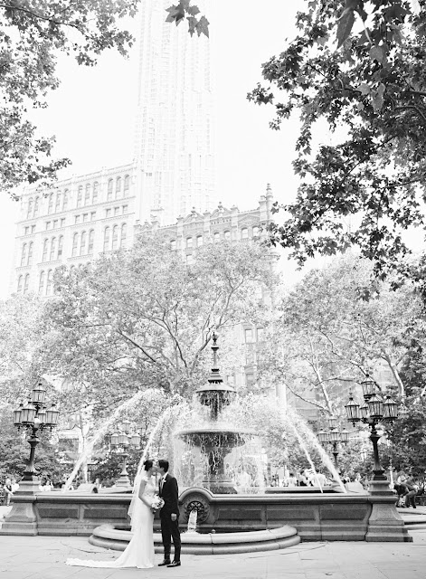 The bride and groom kiss in front of a fountain in New York City | Karen Hill Photography