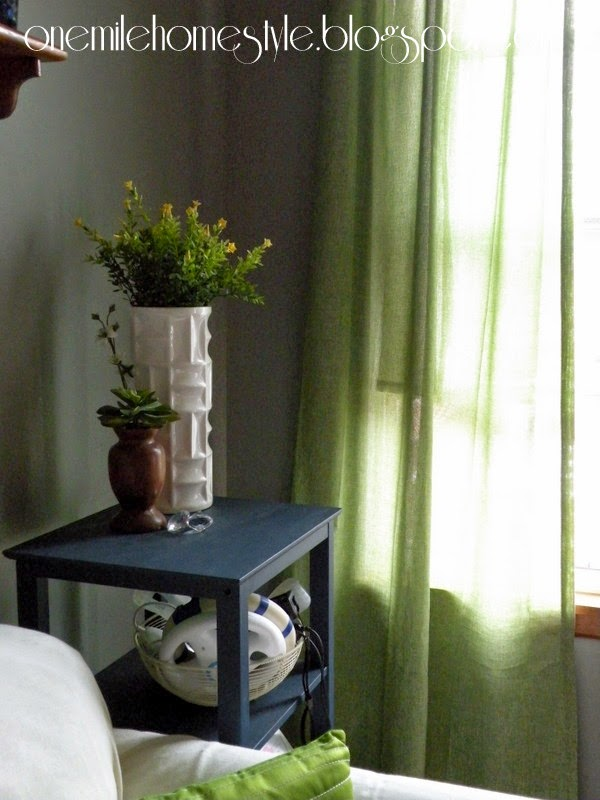 Green linen curtains and spring greenery