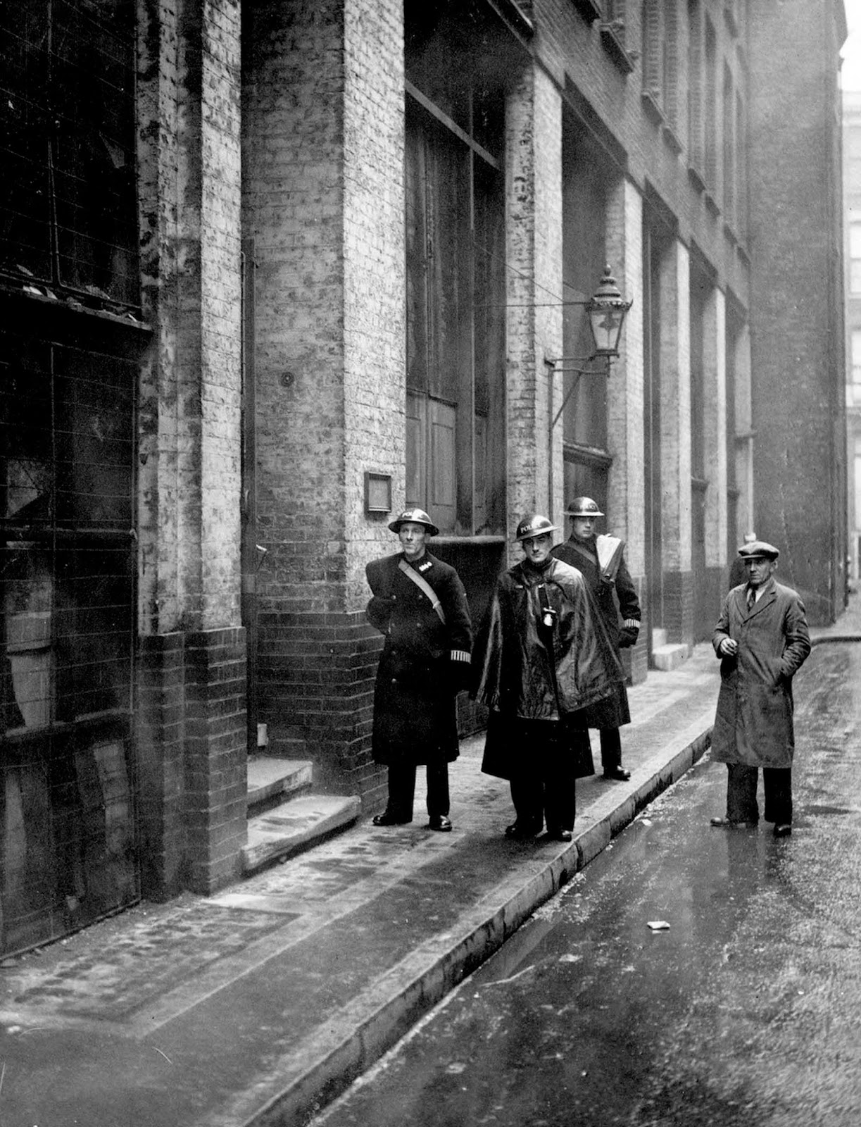 Police on duty outside the offices of 'The Daily Worker' Communist newspaper on Cayton Street, East London. On the evening prior to this detectives enforced a suppression order issued against the publication by The Home Secretary, Herbert Morrison. Printing was stopped immediately. 1941.