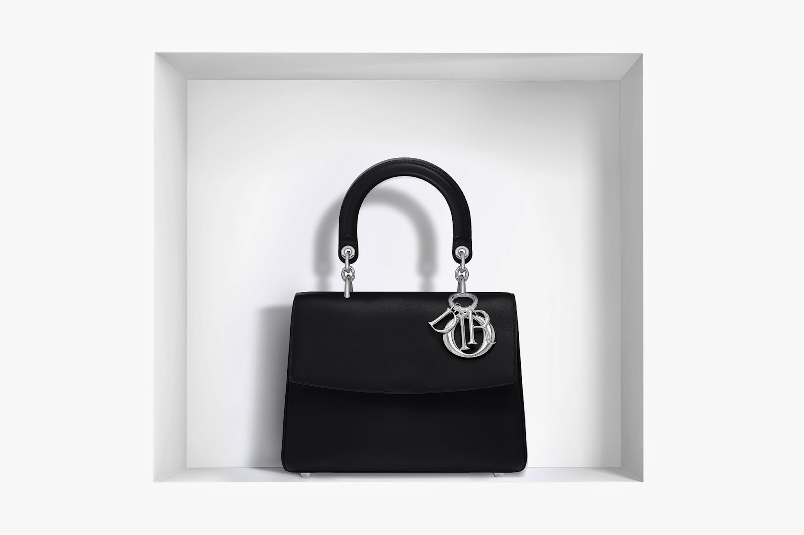73cb52502a You would see luxurious rose Dragee leather inside the bag. The bold twist  to Dior handbag is added by designer through silver tone details.