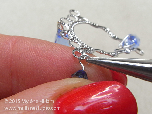 Attaching a crystal dangle through a loop in a silver chandelier earring component