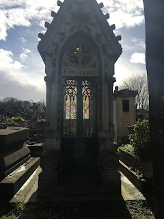 traveling solo female woman wanderlust europe backpack paris france cemetary grave stained glass