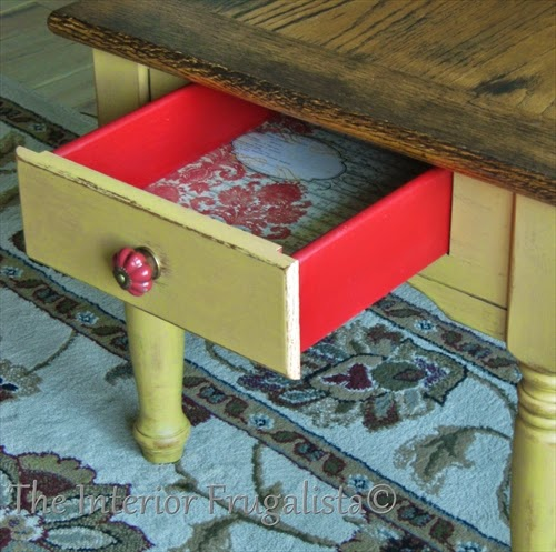 Oak chalk painted side table with vintage scrapbook paper lined and red painted drawers.