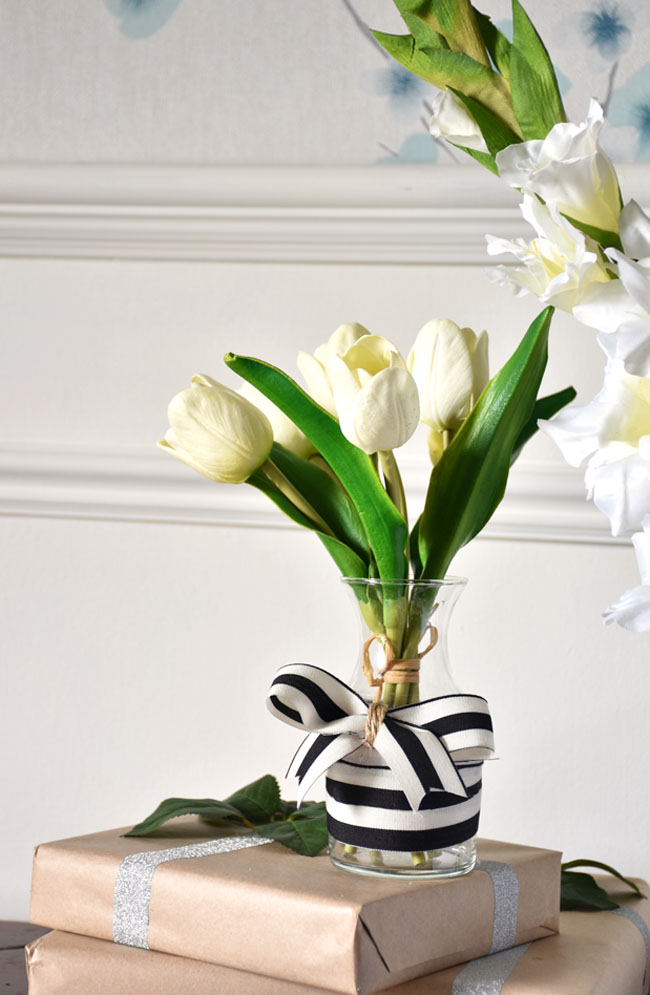 Quick diy vase decoration using ribbon in your color scheme for Christmas.