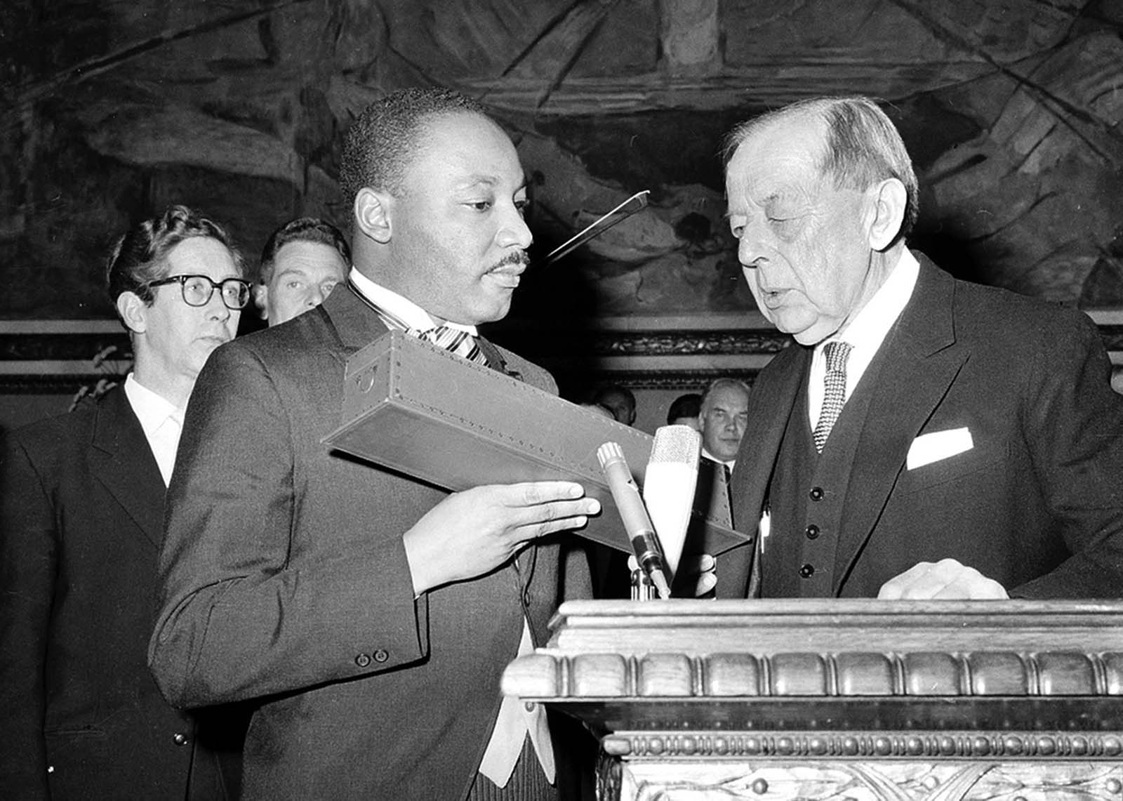 Dr. Martin Luther King Jr. receives the Nobel Peace Prize from the hands of Gunnar Jahn, Chairman of the Nobel Committee, in Oslo, Norway, on December 10, 1964. The 35-year-old Reverend King was the youngest man ever to receive the prize. In the presentation speech, King was praised as a