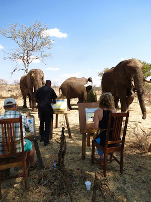 Painting live elephants in Victoria Falls, Zimbabwe