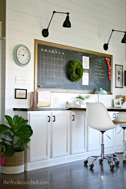 White shiplap wall with lights