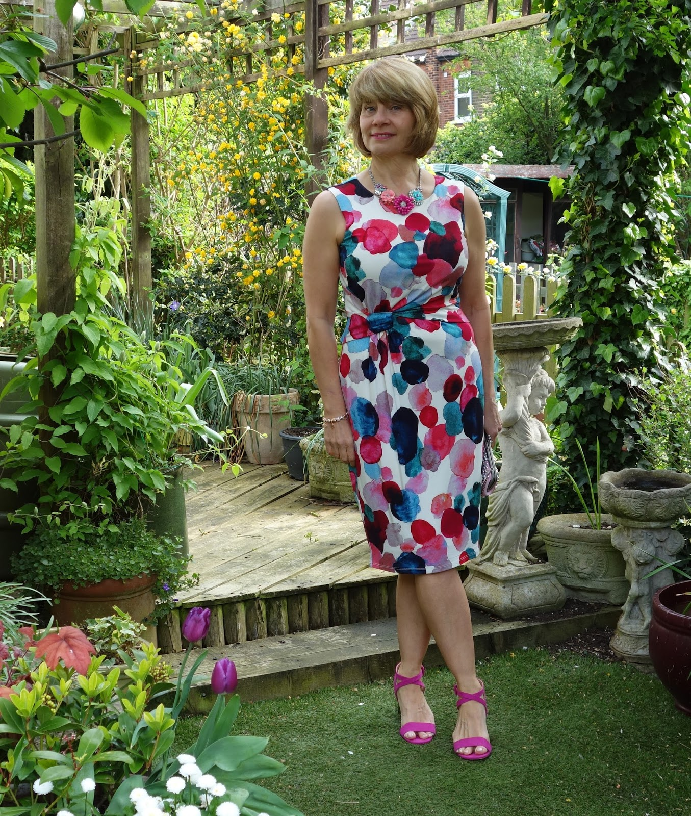 In the garden wearing a painterly frock from Phase Eight