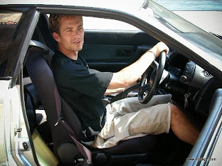 Paul Walker sitting in an R32 GT-R