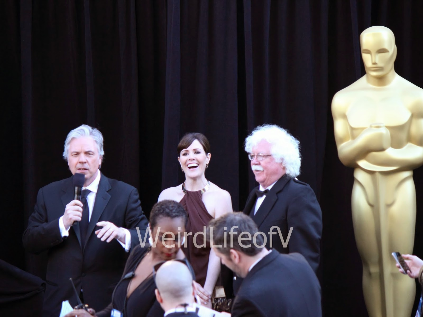 Rachael and Ron MacFarlane being interviewed at the 2013 Academy Awards