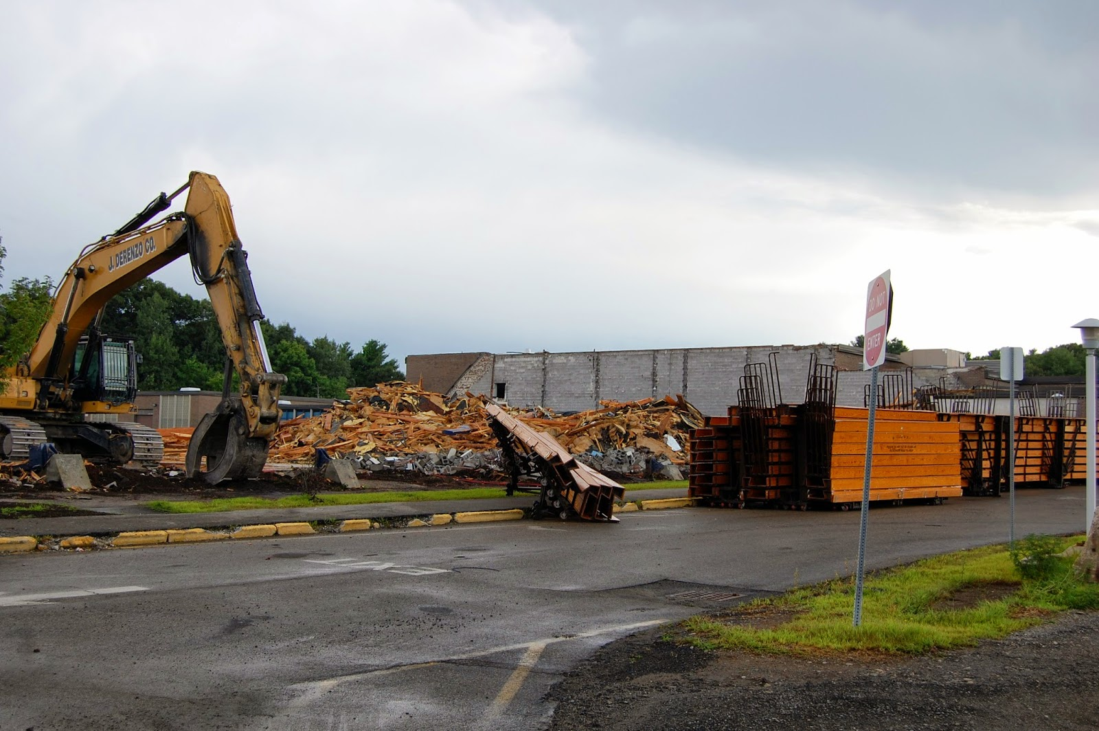 The remaining wall is for the small gym. It shows the arc of where the field house was
