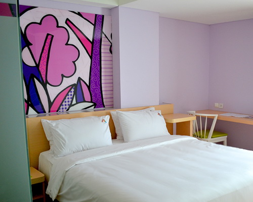 www.Tinuku.com Ivanna Cerelia Suryo studio gives bright graphic design on wall Maxone Hotel in Sukabumi as cheerful touch