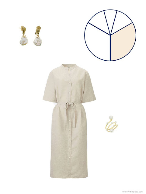 a simple beige dress with pearl jewelry