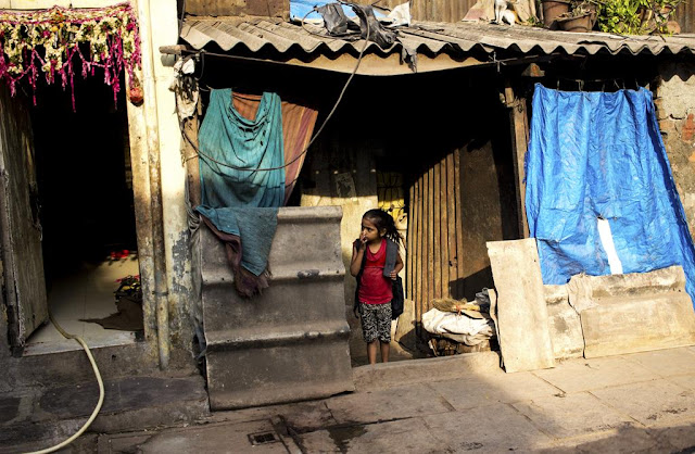 child playing hide and seek kumbharwada dharavi mumbai india street streetphoto