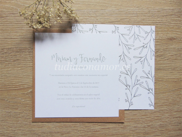 Una invitación de boda de estilo rústico provenzal con ramas de olivo sencillas dibujadas