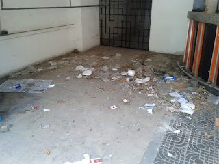 Picture of trash piling up on the floor at the old Equinox in Phnom Penh Cambodia