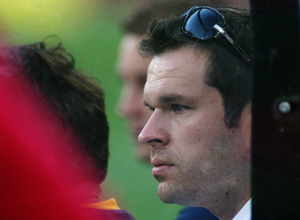 Mark Viduka of Australia watches from the bench during an Australian Socceroos training session at Brisbane Stadium on October 14, 2008 in Brisbane, Australia