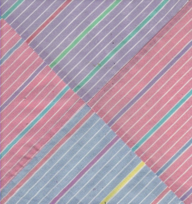 Quilt block sample shows effect of four matching striped fabrics