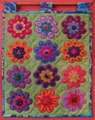 Bodacious Blooms, a wall quilt by Nancy Anders, embroidery on wool applique