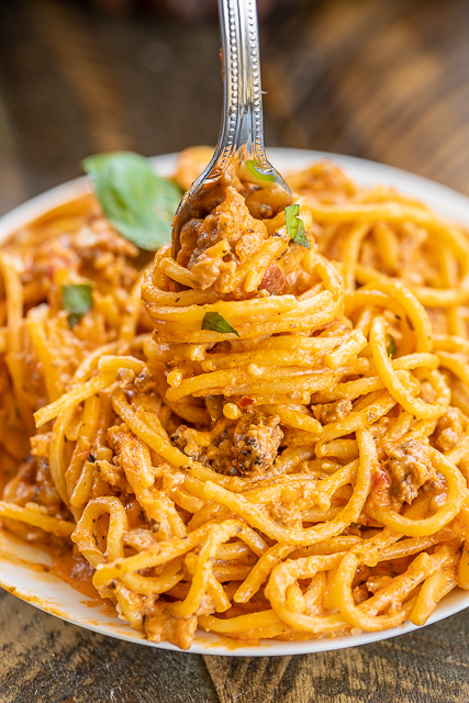 Instant Pot Cream Cheese Spaghetti - so creamy and delicious! Better than any Italian restaurant!! I wanted to lick the bowl this was so good!! Italian sausage, garlic, Italian seasoning, spaghetti, spaghetti sauce, beef broth, cream cheese and parmesan cheese.  Cooks for 9 minutes! Everyone cleaned their plate and went back for seconds. This is a new favorite!!! #instantpot #spaghetti #pasta #instantpotrecipe #italian