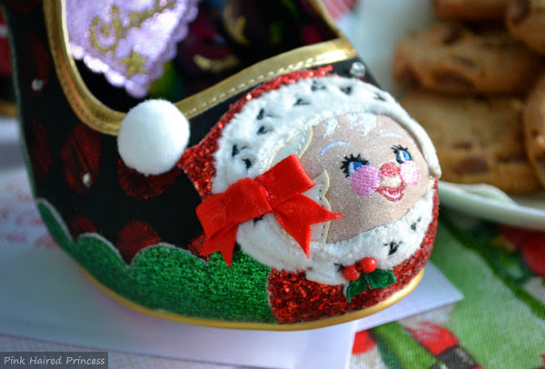 tip of shoe showing applique Mrs Claus with green and red glitter, fur, pom pom and satin bow