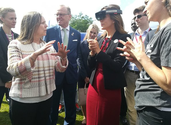 Crown Princess Mary wore Dolce and Gabbana red scoop neck wool crepe dress and Dolce & Gabbana Sunglasses