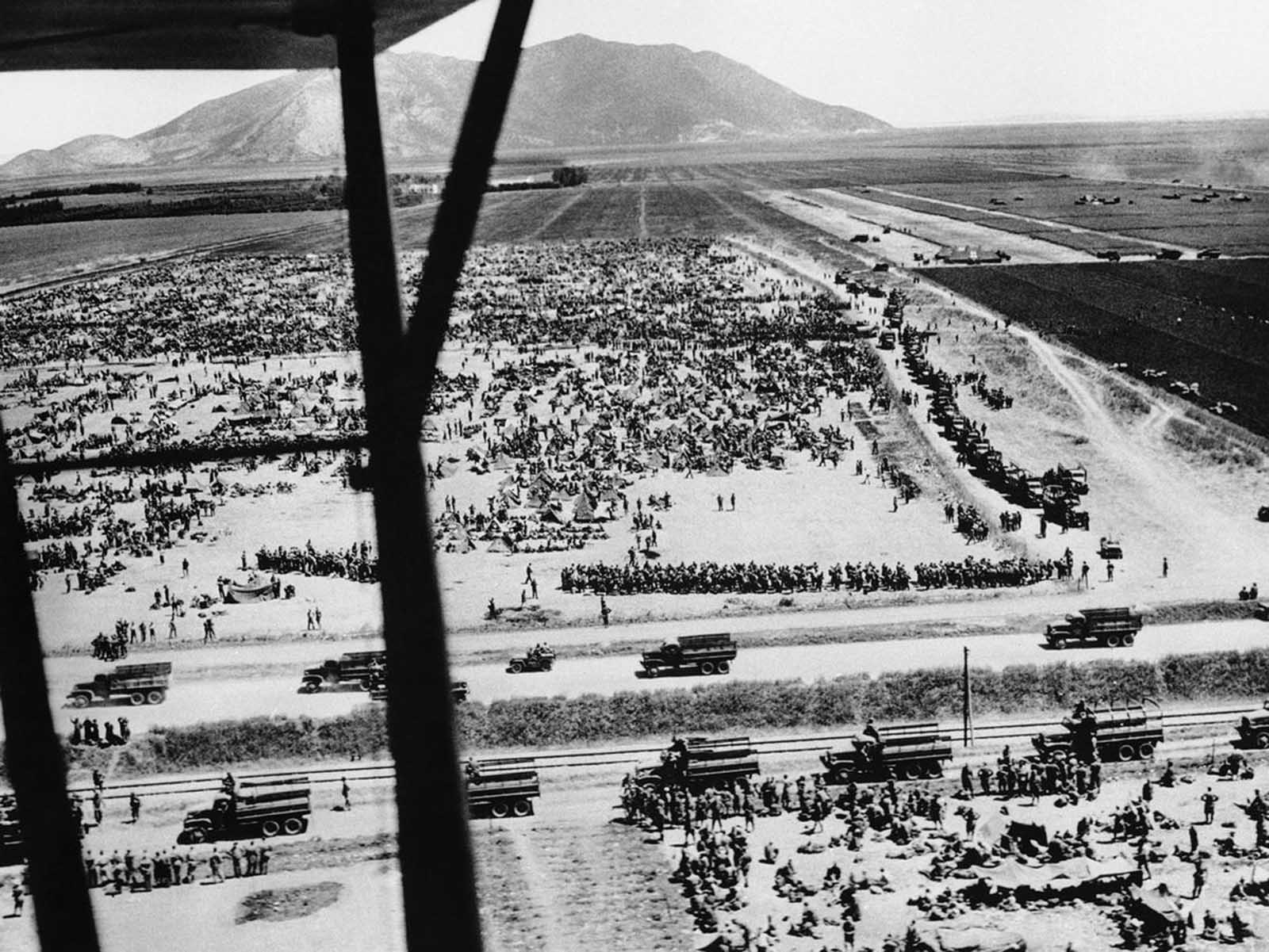 After the surrender of Axis forces in Tunisia in May of 1943, Allied forces took more than 275,000 prisoners of war. Shown here is one roundup of thousands of German and Italian soldiers in Tunisia seen in an Army Air Forces aerial shot, on June 11, 1943.