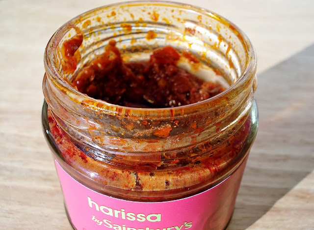 open jar of harissa paste