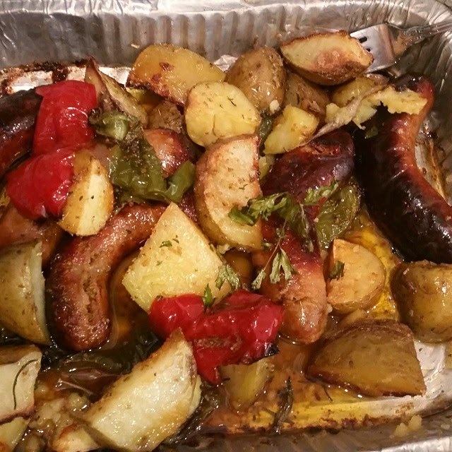 Sausage baked in the oven with roasted potatoes and peppers and Italian classic casserole