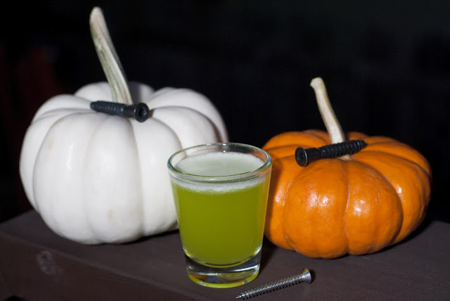 Halloween cocktail shot, Frankenstein, pineapple juice, melon liqueur, Midori, blackberry schnapps