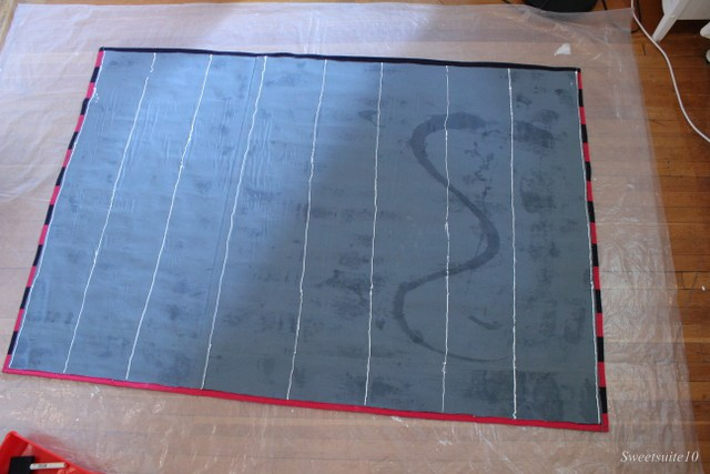 Caulk on the back of a rug to prevent slipping