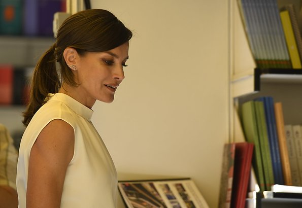 Queen Letizia wore Hugo Boss Exina sleeveless top, and the queen wore Hugo boss denim skirt jeans