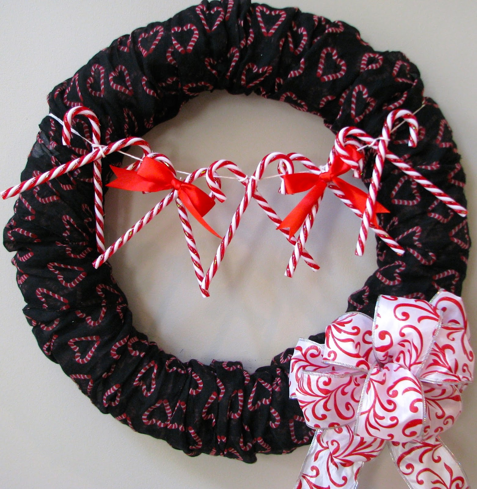 wreath with row of candy canes and a bow