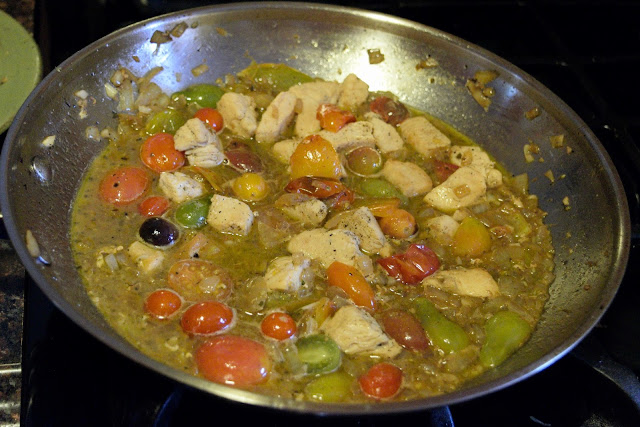 The wine reducing in the skillet with the tomatoes, chicken, onions, and garlic.