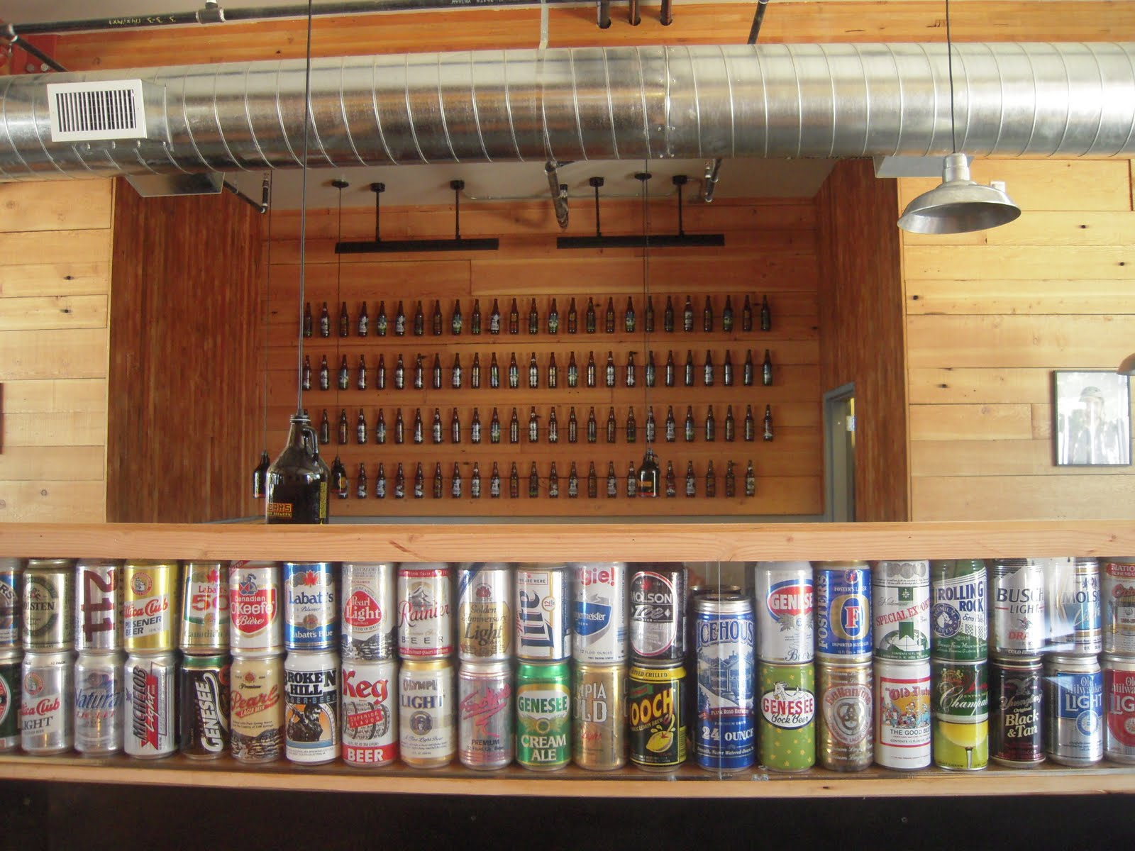 Separating The Bar Side Of E From Restaurant Short Wall Features A Gl Case Displaying Old Vintage Beer Cans That Owner
