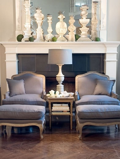 bergere chairs grey fabric living room fireplace