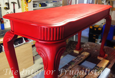 Red sofa table close-up painted with milk paint