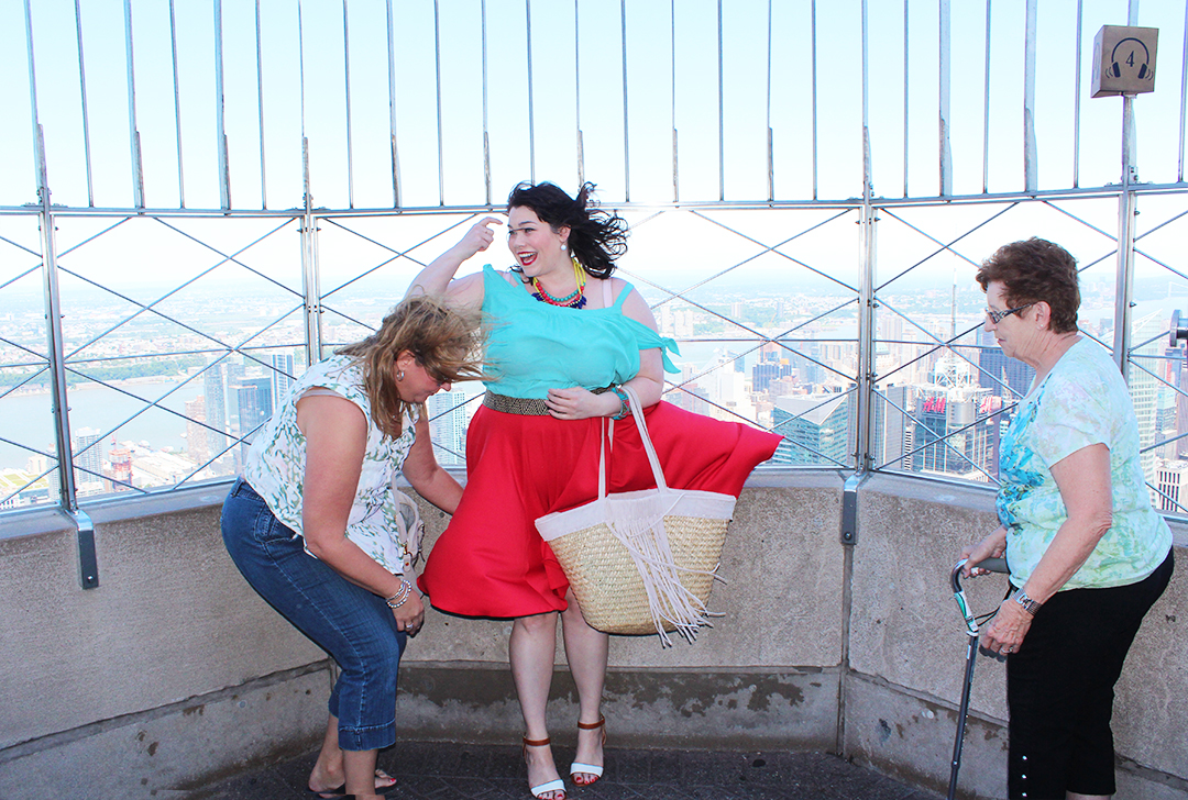 Plus Size Blogger Style Plus Curves at Empire State Building in Red Skirt and Blue Top