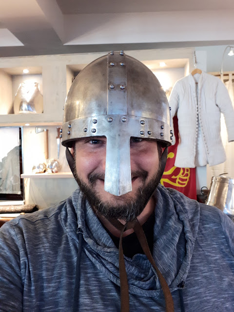 The Social Traveler with a medieval helmet at Carcassonne