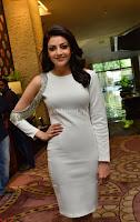 Beautiful Smiling Kajal Aggarwal in Creamy White Gown at MLA Telugu Movie Success Meet ~ .com Exclusive Pics 011.jpg