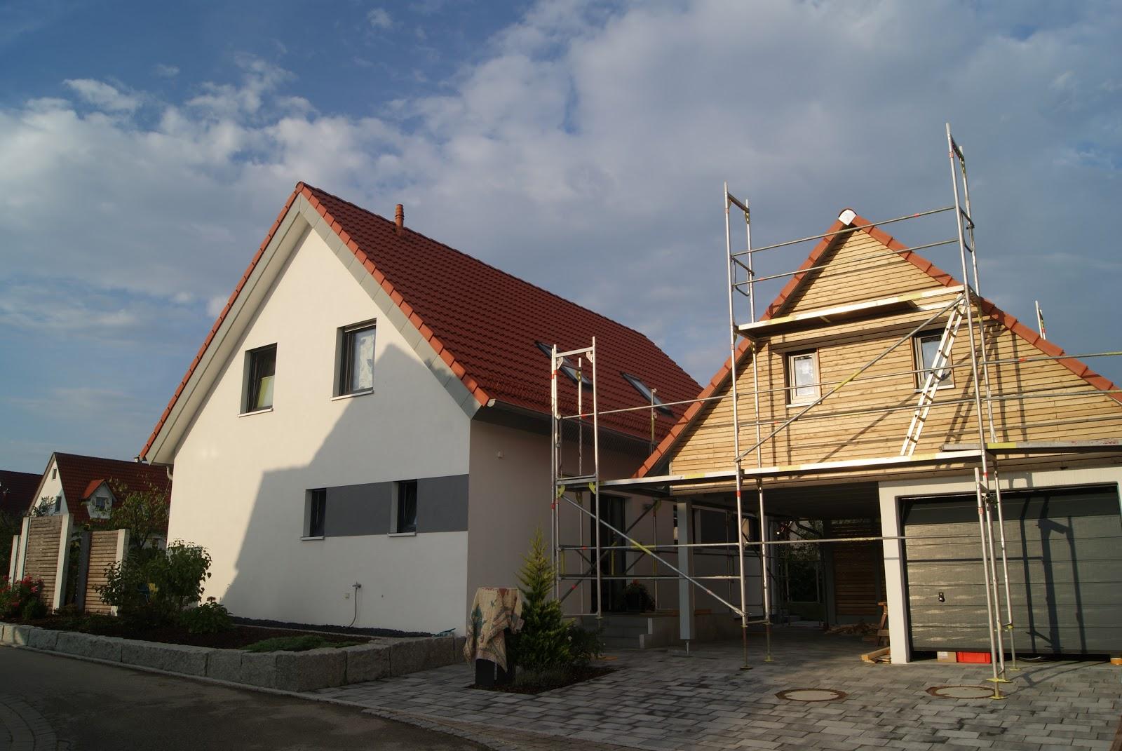 Carport + Dach über Garage und Carport