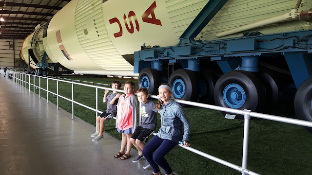 Kids in front of Saturn V - Space Center Houston