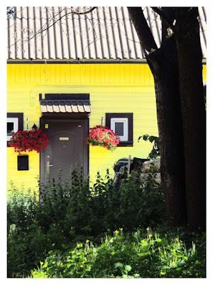 glowing yellow cottage, Parnu, Estonia photo by sue wellington