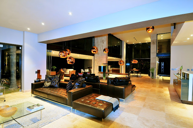 Picture of black modern furniture in the living room as seen at night