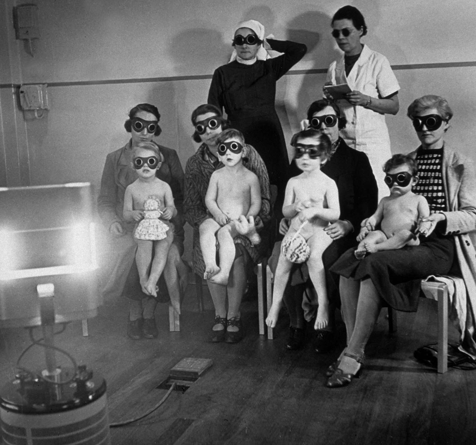 Children receiving ray treatment at the child welfare centre in Harrow Road, West London. 1938..