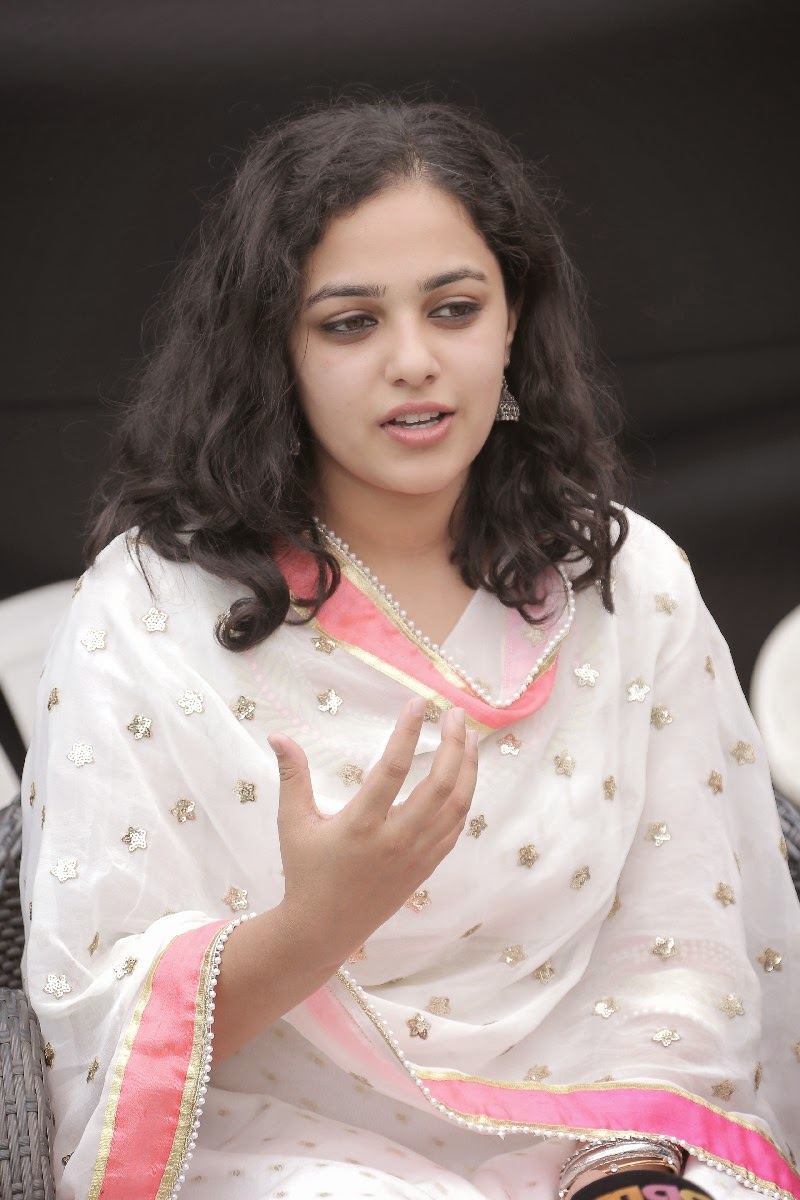 Actress Nithya Menon Smiling Face Closeup Photos In White Dress