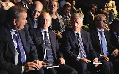 Vladimir Putin with Bolshoi Theatre Director Vladimir Urin (left) and President of Finland Sauli Niinisto during a performance of the opera Iolanta at Olavinlinna Castle.