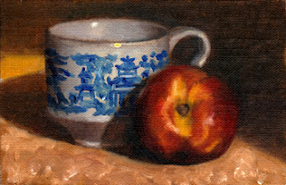 Oil painting of a willow pattern teacup beside a yellow nectarine.